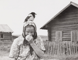 Vepsian woman with magpie